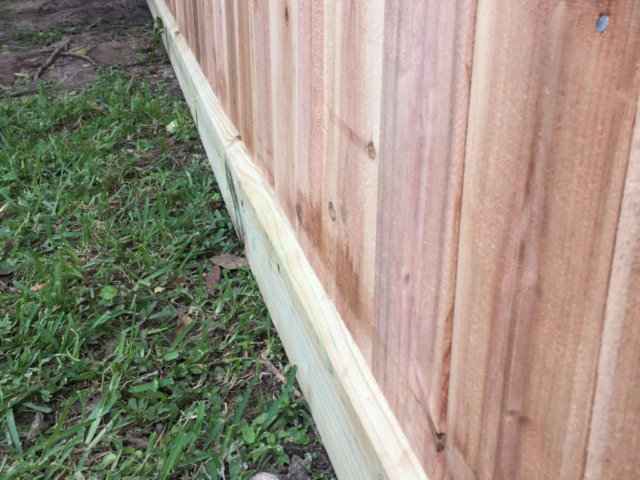 Cedar fence pickets and rot board