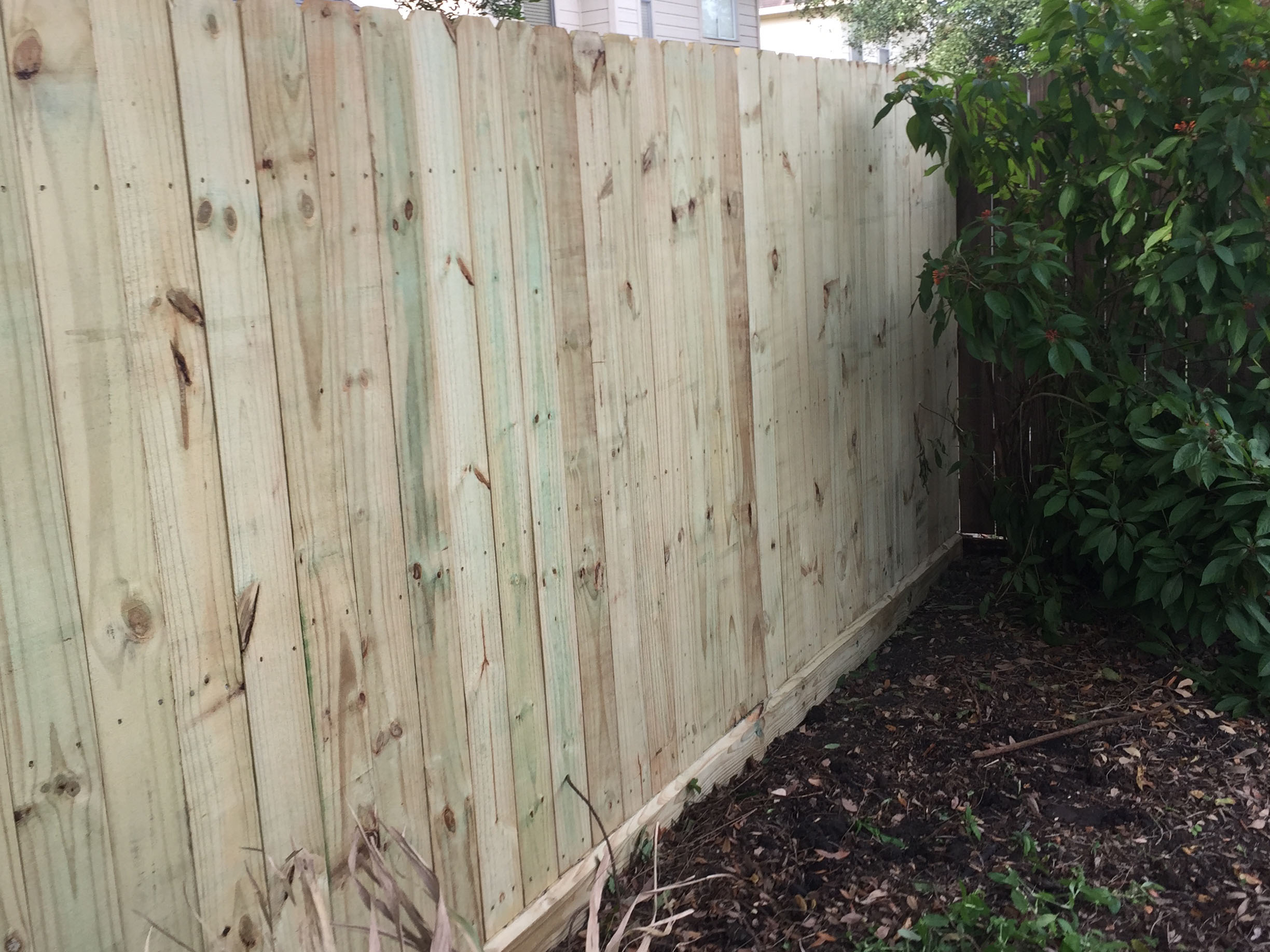 Pine Wood Fence with Beveled Rot Board Residential Installation