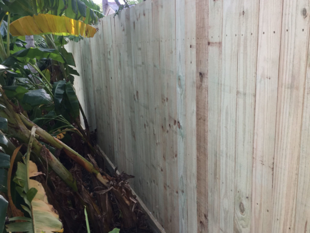 New Wood Pine Fence with three rails and rot board.